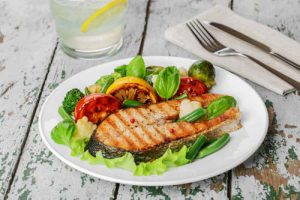 steak grilled salmon with vegetables on a plate