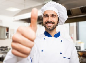 Portrait of a smiling chef giving thumbs up