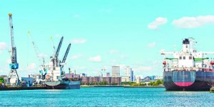 Panormic image of docking container ships in Rotterdam harbor
