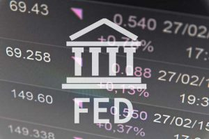 "Building icon with inscription ""Fed"". Financial data on computer"
