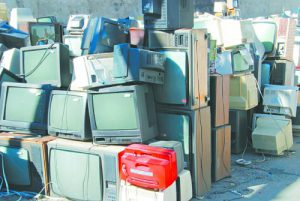Dump of old broken computers and TVs- place where modern technology ends forever