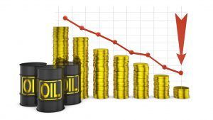 barrels of oil and a stack of coins on the background of the graph of lowering