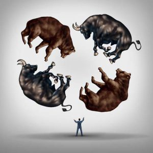 Investing in stocks concept as a financial advisor or stock broker businessman juggling a group of bears and bulls as a symbol and metaphor for the challenge and skill required for financial management of an investment portfolio.