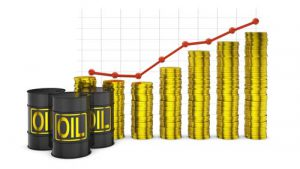barrels of oil and a stack of coins on the background of the rising graph