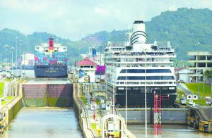 Ships move through the Miraflores Locks, the first set of locks on the Pacific side of the Panama Canal, Saturday, Oct. 4, 2003. According to the Panama Canal Authority, 13 to 14 thousand boats transit the Panama Canal every year. (AP Photo/Kathryn Cook)