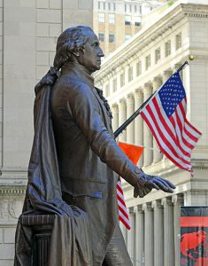 George Washington statue with American flag at Federal Hall in N