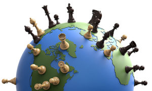 symbol of geopolitics the world globe with chess pieces